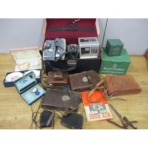 36 - A mixed lot to include cased cameras, jewellery and boxed china...