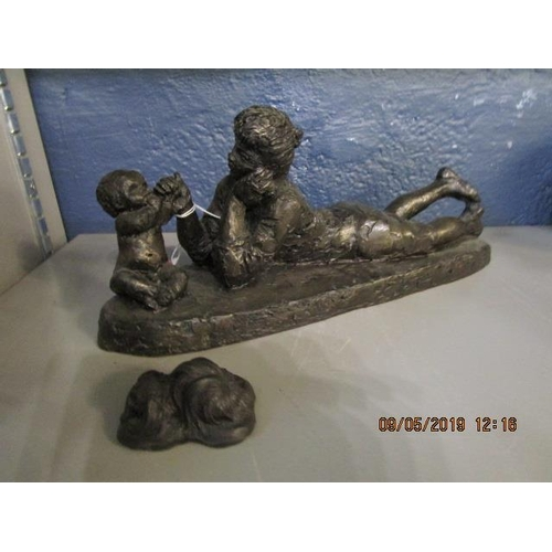 45 - A Heredities composition bronzed figurine of a woman playing with a young child and a small model of...