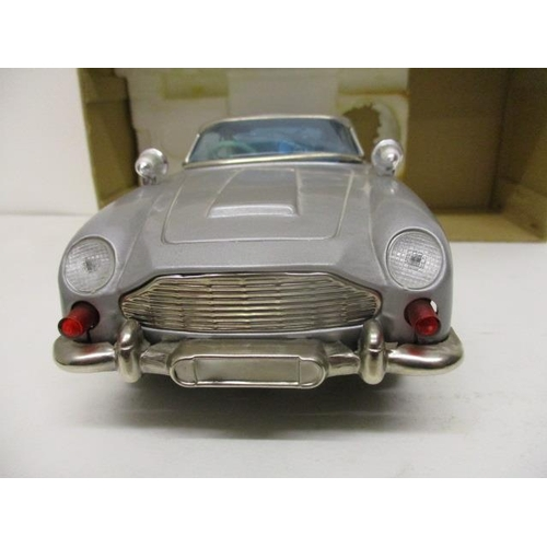 2 - An ASC Aston-Martin Mystery Action toy car, battery operated, 11