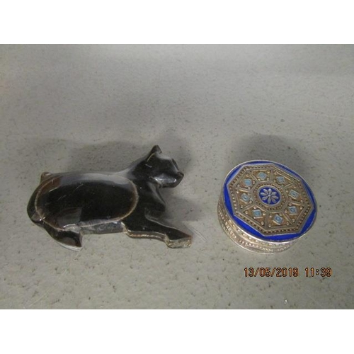 54 - A small continental silver and enamel pill box and a cat snuff box...