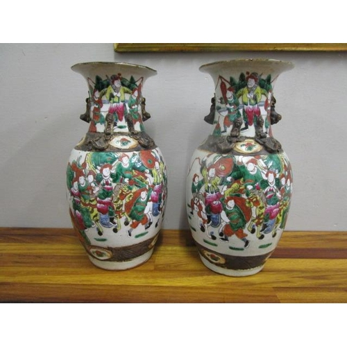 22 - A pair of early 20th century Chinese porcelain vases decorated with various figures, 13 2/8