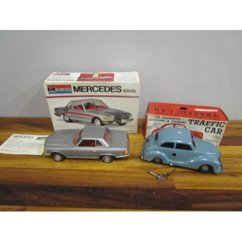 23 - A boxed clockwork Traffic car with key and an American boxed 1.24 monogrammed model of a Mercedes...