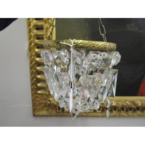 28 - A glass and gilt metal bag light with glass lustre drops and a small machine woven rug...