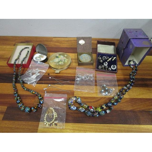 47 - A mixed lot of costume jewellery to include a Venetian and a Bohemian glass necklaces, compact cases...