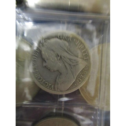 49 - A folder containing various British commemorative coins and coinage to include a half crown 1900, tw...