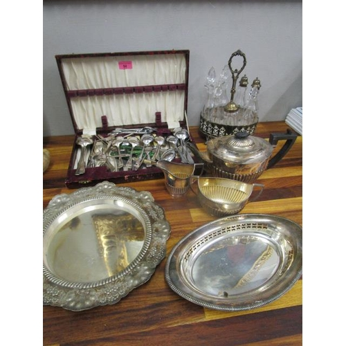 50 - A quantity of silver plated flatware to include a seven bottle silver plated cruet set, bread plates...