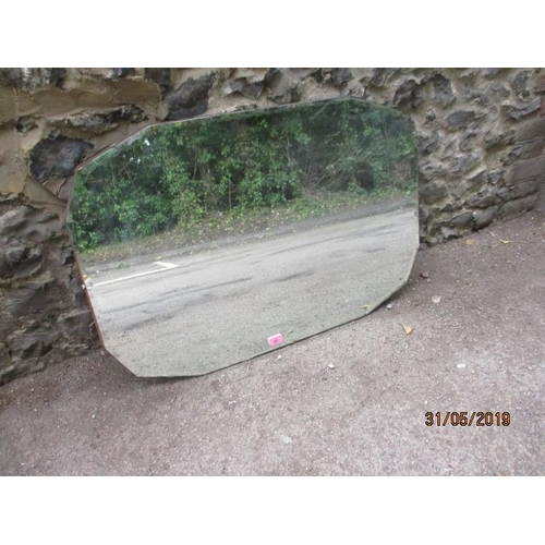 57 - A 1930s wall mirror with a bevelled edge...