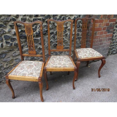 58 - A group of three beech side chairs with carved decoration and drop in seat...
