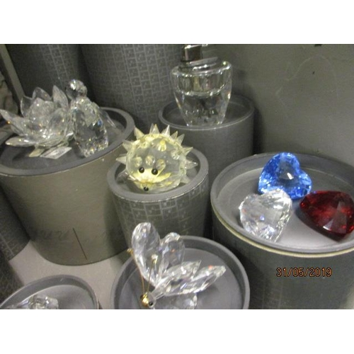 59 - A collection of boxed Swarovski animals, candle holders and others...