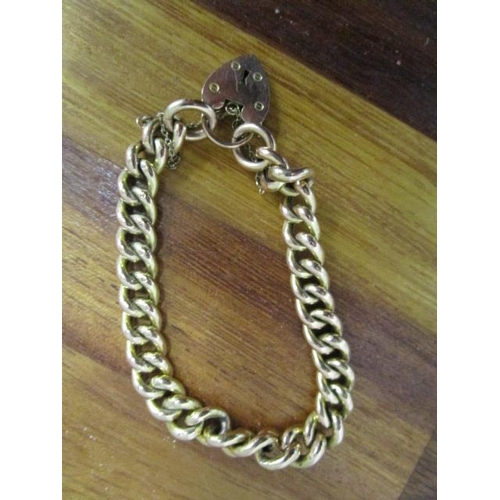 8 - A 9ct gold hollow curb link bracelet with heart shaped catch, 16.4g...