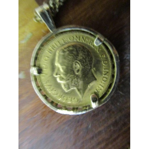 9 - A George V 1914 gold half sovereign set in a 9ct gold setting and on a 9ct gold chain necklace, tota...
