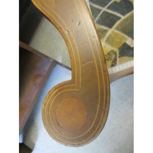 38 - An Arts & Crafts mahogany framed armchair...
