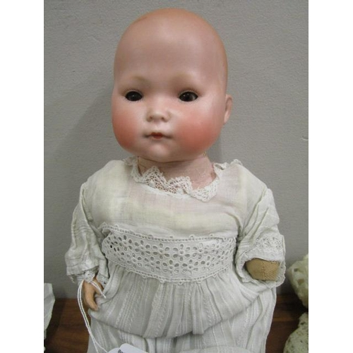33 - An early 20th century German bisque headed doll by William Weygh, circa 1924 with brown sleeping eye...
