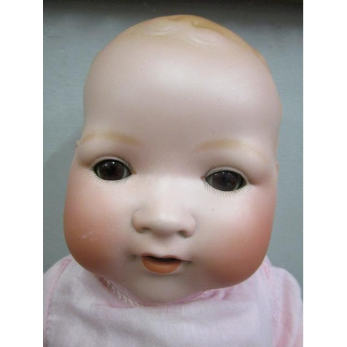 34 - An early 20th century Armand Marseilles Dream Baby bisque headed doll with brown sleeping eyes, open...