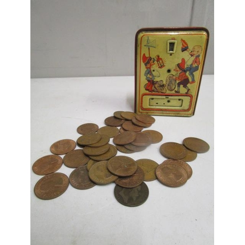 37 - A tin plate money box circa 1950, with counter to the front, the door only opening upon the 36th pen...
