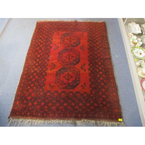 123 - A red ground Bokhara rug...