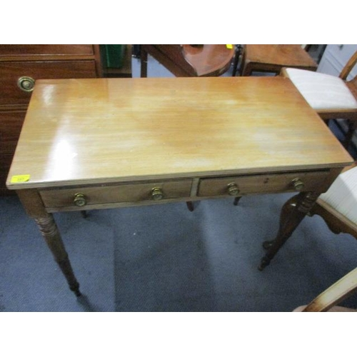 124 - A Victorian mahogany side table on ring turned legs...