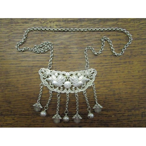 106 - A contemporary Chinese white metal plaque necklace with pierced lion dog and pearl decoration, with ...