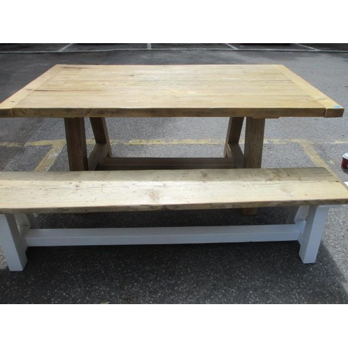 118 - A pine plank constructed trestle style kitchen table with one matching bench originally purchased fr...