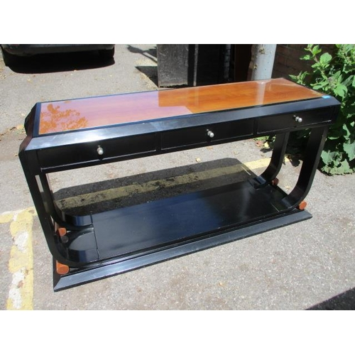 119 - A Chinese style black lacquered console table with three small drawers...