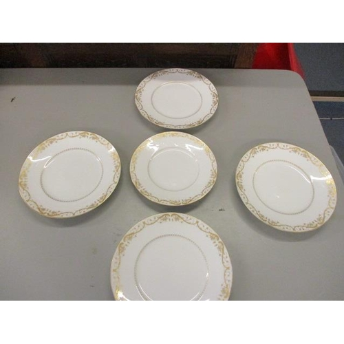 12 - A set of five Royal Copenhagen plates with floral and scroll pattern...