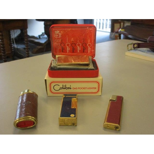 14 - A set of four lighters to include Colibri, Mulberry and Dunhill...