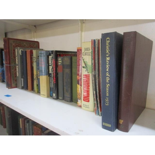 22 - A mixed lot of books to include 'Live and Let Die' by Ian Fleming...
