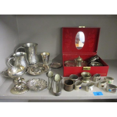26 - Silver to include a silver Armada style dish, sugar tongs, a pierced dish and a twin handled cup and...