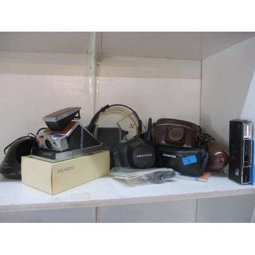 3 - A mixed lot of electrical items to include a phone, a walkie talkie and a Polaroid land camera...