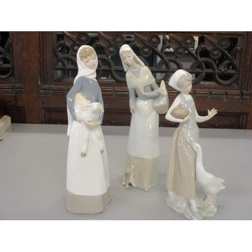 5 - Three Lladro figures in the form of young girls with geese and a lamb...