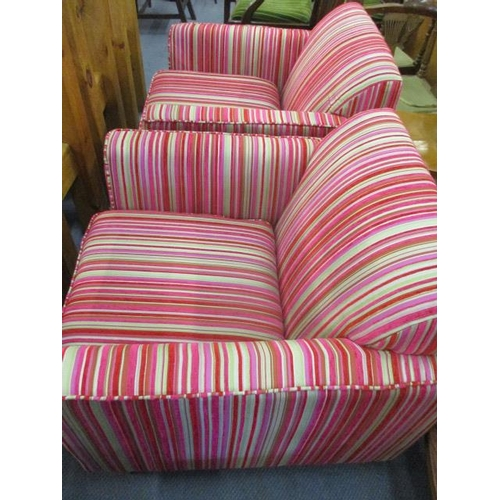 99 - A pair of Cargo multi coloured fabric upholstered armchairs...