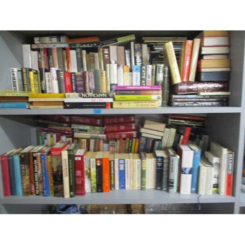 104 - A large collection of household books and novels to include Len Deighton...