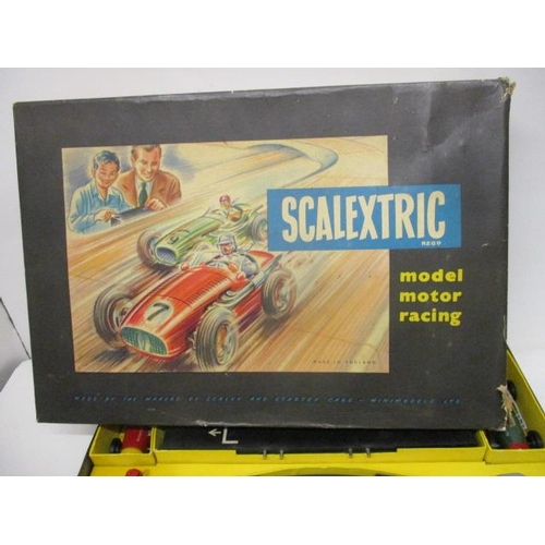 5 - A late 1950s Scalextric boxed set with tin plate cars, track, box to house, the batteries with conne...