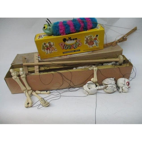 20 - An early skeleton Pelham puppet with original box, together with a 1960s caterpillar Pelham puppet w...