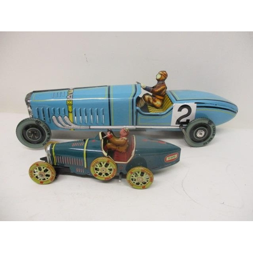 3 - Two reproduction painted, pressed metal clockwork toy racing cars, 7