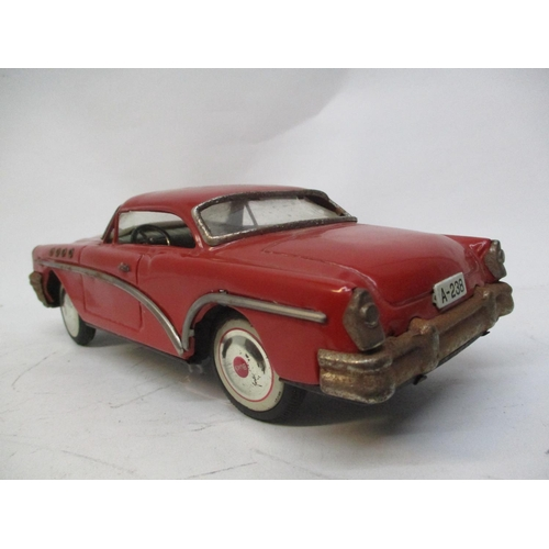 11 - A 1950s/60s KO Japanese Buick red tinplate car, 3 1/4