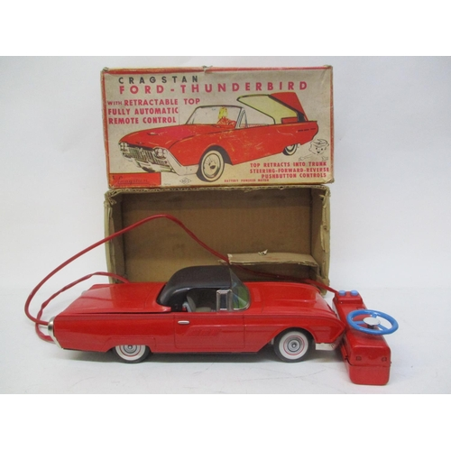 12 - A 1950s/60s Cragstan Ford Thunderbird remote control car with retractable top with original box...