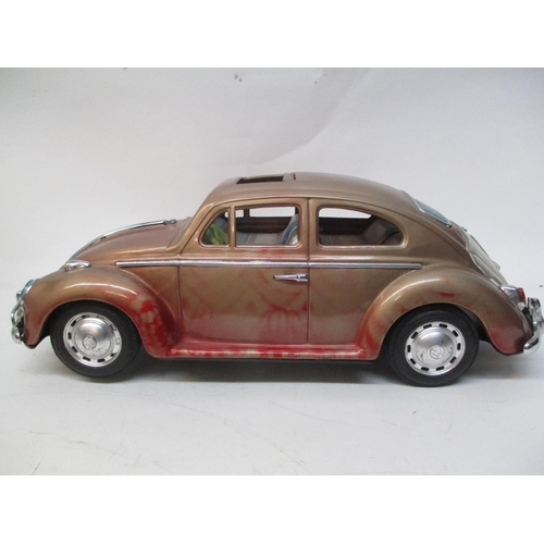 14 - A 1960s Bandai Japanese large scale tinplate Volkswagen Beetle, 5 1/4