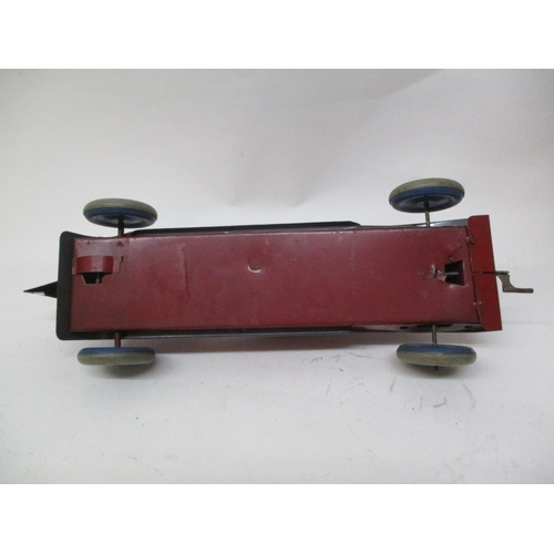 17 - A 1920s Friction Drive tin plate red racing car, stamped BTE to the underside, possibly by Charles R...