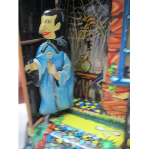 19 - A 1950s/60s battery operated Marx Hootin Hollow Haunted House, with original box...