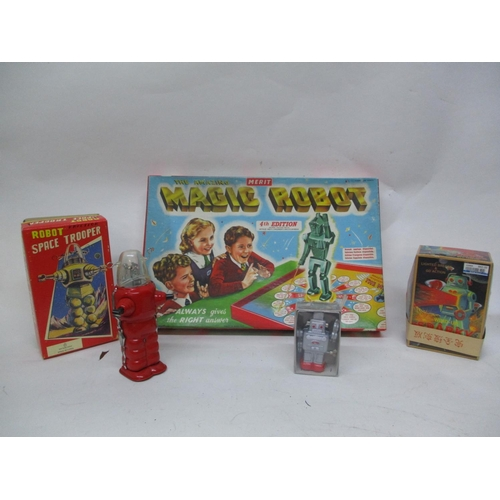 21 - A wind up Sparky Robot, a wind up Smoking robot, a robot space trooper and a Merit The Amazing Magic...