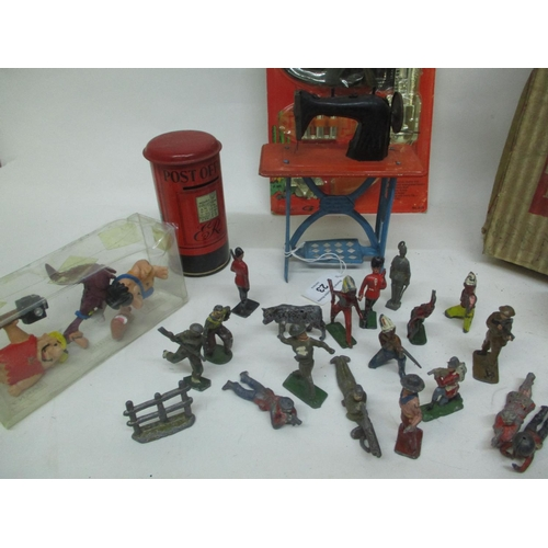 23 - A mixed lot of vintage toys to include lead toy figures, Flintstone figures, a Post Office moneybox,...