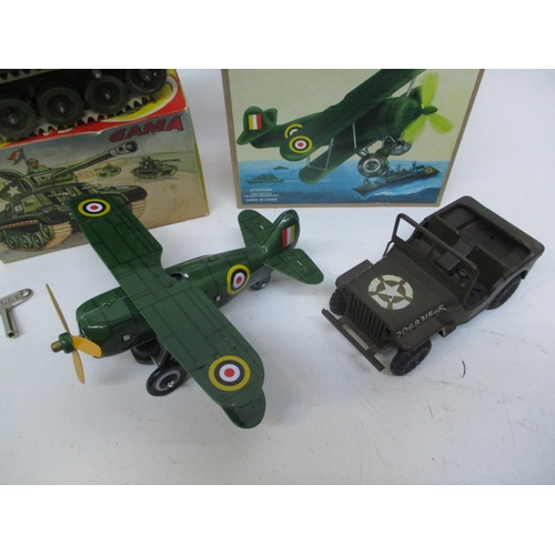 26 - A 1950s/60s clockwork boxed Gama tank, together with a 1950s/60s clockwork Triang jeep and a reprodu...
