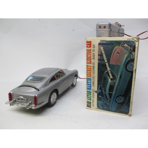 9 - A 1960s Japanese M101 Aston Martin Secret Ejector car with original Bond and Villain figure and orig...