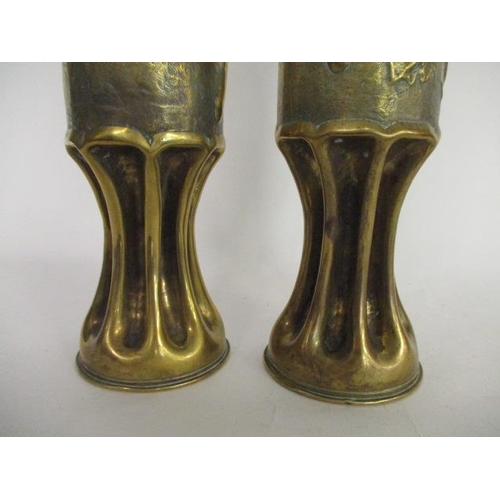 40 - A pair of 1915 Great War trench art artillery shells with pinched bases, embossed with a bunch of gr...