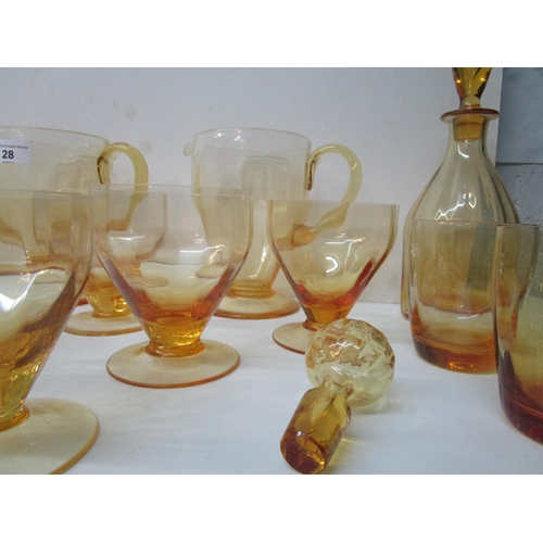 28 - Whitefriars Golden amber ribbed table glass, water sets comprising two water jugs, pattern M74 with ...