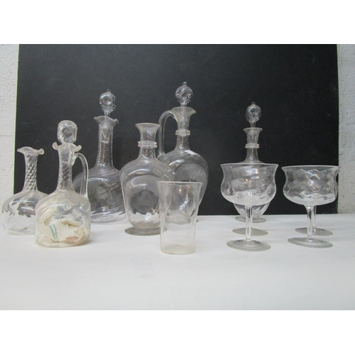 30 - Harry Powell for Whitefriars Glass - a group of spiral ribbed decanters, a claret jug, oil bottles a...