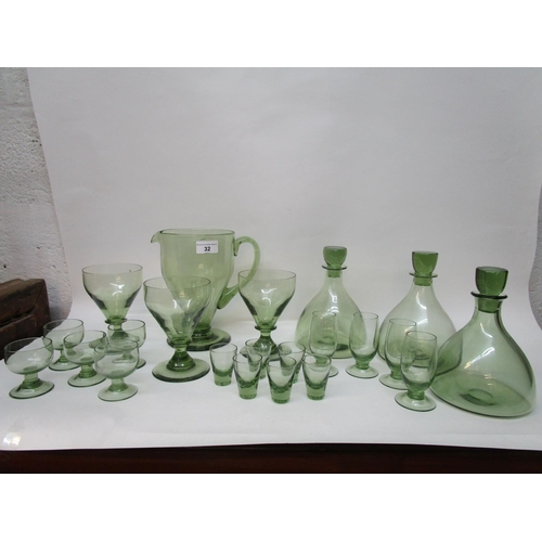 32 - Barnaby Powell and William Wilson for Whitefriars Glass - a group of table ware in sea green compris...