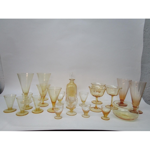 33 - Harry Powell for Whitefriars Glass -a quantity of Golden Amber table glass with vertical moulded dec...