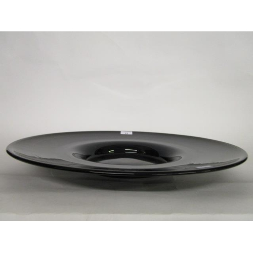 13 - Pauly & Co Venetian, a large Murano glass charger in a deep purple colour, circa 1925, makers price ...